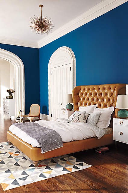 camel bed blue wall